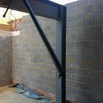 Brick wall and steel beams construction